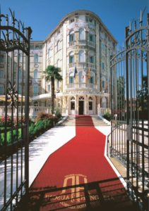 The entrance of the Grande Albergo Ausonia & Hungaria at the Venice Lido with the wrought iron gates of Fucina Artistica Boranga opened